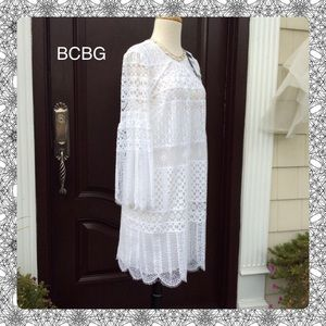 Chic New BCBG LACE Dress with Bell Sleeves.